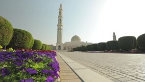 Beautiful view of the Sultan Qaboos Grand Mosque in Muscat, Oman. Panning motion. Beautiful view of the Sultan Qaboos Grand Mosque in Muscat, Oman. Amazing stock footage