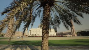Beautiful view of the Sultan Qaboos Grand Mosque in Muscat, Oman. Panning motion. Muscat, Oman - February, 2019: Beautiful view of the Sultan Qaboos Grand Mosque stock video footage