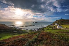 A beautiful view of the sun setting over Cape Cornwall, England royalty free stock images