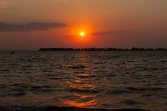 Sunrise above water stock images