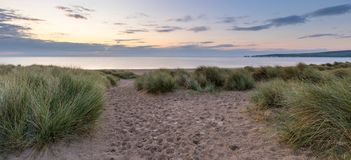 Beautiful view at sunrise over bay. From dunes in Studland Bay, Dorset, England Royalty Free Stock Image