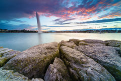 Sunset at lake in the Cityscape. Beautiful view of sunset on the lake of Geneva and the cityscape of Geneva city as silhouette, Switzerland Stock Image