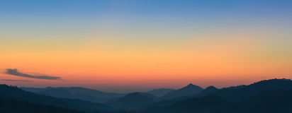 Beautiful view of sunset over mountains Stock Photo