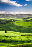 Beautiful view of the sunset over the valley in Tuscany Royalty Free Stock Photo