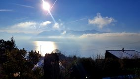 The lake and the Alps royalty free stock image