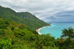 Beautiful view to a beach from top of a mountain. This beautiful beach is located at Paraíso, a town in Barahona Province, in the Southwest of the Dominican Royalty Free Stock Image