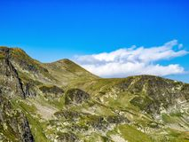 Beautiful view to Bulgarian Rila Mountains steep rocky slopes. In summer royalty free stock photo