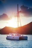 Beautiful view to catamaran in Seychelles bay at sunset Royalty Free Stock Photo