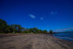 Beautiful view to Rangitoto Island from Karaka Bay Beach Auckland New Zealand in a blue sky in sunny day Stock Photo