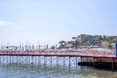 Beautiful view to Rapallo beach pier, blue sea and mountains Royalty Free Stock Photo