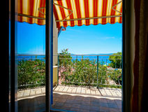 Beautiful view to sea from the inside of apartments. Balcony wit Stock Images