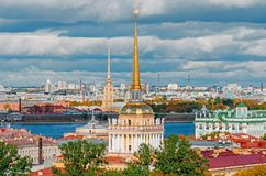 Beautiful view to spires of Admiralty and Peter-Pavel`s Fortress from Isaac cathedral, Saint Petersburg, Russia. Stock Photos