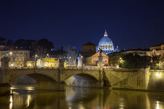 A beautiful view to St. Peter's basilica at night from the bridge. Rome, Italy - February 28, 2013: Beautiful view to St. Peter's basilica at night from the Royalty Free Stock Photo