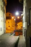 Beautiful view to an stairway in an italian village at night. Brighten by street lights long time exposure at night royalty free stock photo