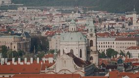 Beautiful view from the top of the most famous baroque church in Prague the Church of St Nicholas and traditional Czech. Roofs. General plan 4k stock video