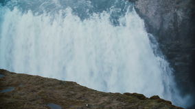 Beautiful view from the top of the mountain on the Gullfoss waterfall in Iceland. Water falls down from the cliff. stock video