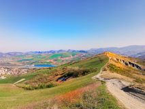 Beautiful view from the top of the mountain to the surrounding hills and cities in italy in the Modena region,a motocross track at stock photo