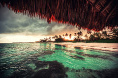 Beautiful view toward tropical beach from wooden water villa Stock Photography
