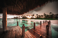 Beautiful view toward tropical beach from wooden water villa Royalty Free Stock Images