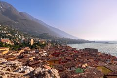 Beautiful view of town Malcesine and the Alps mountains on Lago di Garda, skyline view. Veneto, Italy royalty free stock image