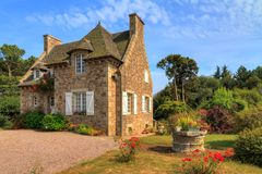 French country house in Brittany. Beautiful view of a traditional French country house in Brittany, France, in summer with a blue sky Stock Image