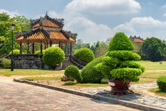 Beautiful view of traditional Vietnamese pavilion in Hue. Beautiful view of traditional Vietnamese pavilion on blue sky background at garden of the Imperial City royalty free stock photography