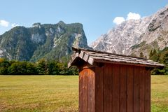 Beautiful view of traditional wooden boat house at the shores of famous Lake Obersee in scenic Nationalpark stock photo