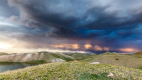 View of Tulpar Kul lake in Kyrgyzstan during the storm Royalty Free Stock Image