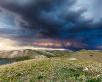 View of Tulpar Kul lake in Kyrgyzstan during the storm Royalty Free Stock Photos