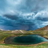 View of Tulpar Kul lake in Kyrgyzstan during the storm Royalty Free Stock Photo