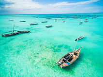 Beautiful view of turquoise ocean water and wooden boats. Beautiful view of turquoise ocean water and wooden fishing boats on it, aerial photo Royalty Free Stock Image