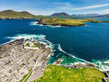 Beautiful view of Valentia Island Lighthouse at Cromwell Point. Locations worth visiting on the Wild Atlantic Way. Scenic Irish countyside on sunny summer day stock photos