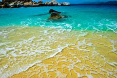 Beautiful view of Virgin Gorda`s beached with the contrasting colours of the the sand, the sky and the crystal clear water stock image
