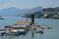 Beautiful view of the Vlacherna Monastery in Corfu in summer season. The small monastery is the emblem of Corfu in the middle of the bay, with the island in the Stock Images