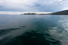 Beautiful view of the water of Lake Baikal per day with clouds in the sky.View from the water. stock image