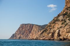 Beautiful view from water at yellow and orange Crimean mountain landscape near Balaklava at sea coast. Summer travel and journey. Concept royalty free stock photography