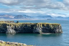 Beautiful view from the west coastline of Iceland. The west coastline of Iceland with mountain peaks and strange lava formations on a beautiful sunny autumn day stock images