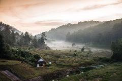 Beautiful view with white fog and small house at Pang Ung Lake M Stock Photos