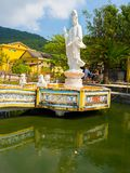 Beautiful view of a white stoned statue in the border of the pier, bin Hoian in Vietnam. Hoian is recognized as a World Royalty Free Stock Image