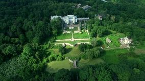 Beautiful view on White Swan palace and yard in Sharivka park, Kharkiv region stock video