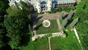Beautiful view on White Swan palace and yard in Sharivka park, Kharkiv region stock footage