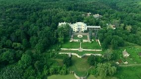 Beautiful view on White Swan palace and yard in Sharivka park, Kharkiv region stock video