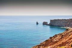 Beautiful view of the wild rocky sea coast. Royalty Free Stock Photos