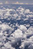 Beautiful view from window of plane flying over clouds. Natural panorama with clouds. White clouds moving above the ground stock photos