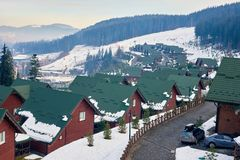Wooden houses in Bukovel. Beautiful view of wooden houses and mountain in winter in Bukovel stock photos
