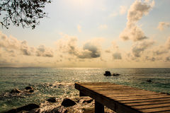 Beautiful view of wooden pier before sunset. On beach at Monnok island, Rayong, Thailand Royalty Free Stock Photos