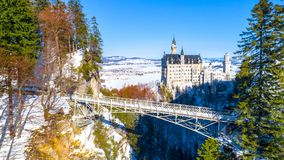 Beautiful view of world-famous Neuschwanstein Castle, the nineteenth-century Romanesque Revival palace built for King Ludwig II on. A rugged cliff near Fussen stock photo