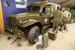 WWII ambulance USA. Beautiful view of WWII equipment USA Ambulance in the museum Musee Memorial d`Omaha Beach, in Normandy, France, on August 2, 2014 Royalty Free Stock Images