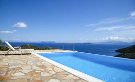 Beautiful views of the infinity pool by the sea Stock Photography