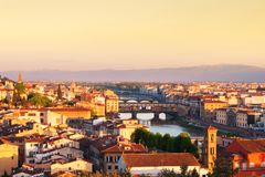Beautiful views and peace of Florence cityscape in the backgroun. D Ponte Vecchio bridge at sunrise in Italy, Europe Royalty Free Stock Photos